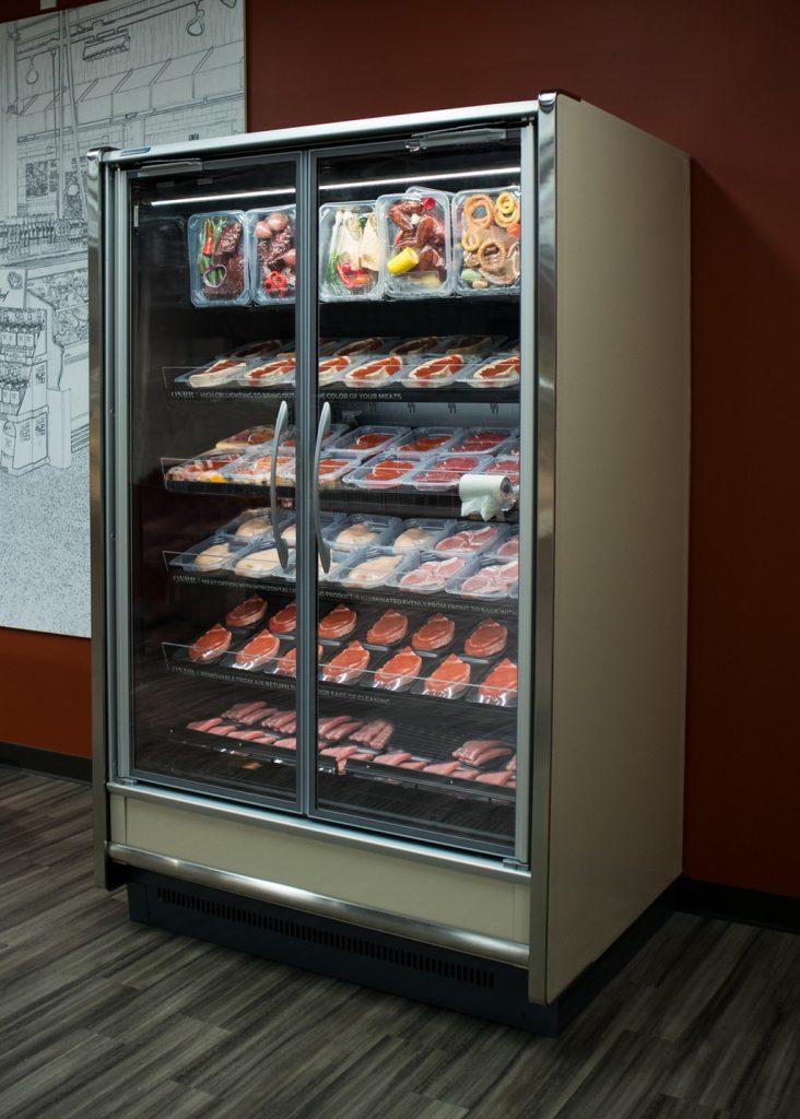 ONRM glass door reach-in medium-temperature fresh meat and protein merchandising display case.